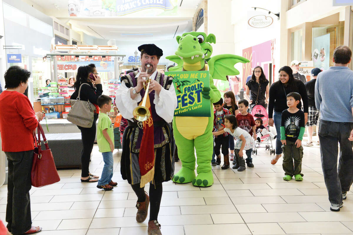 Frolic and Heralder lead children Through Memorial City Mall to the FrolicFest.