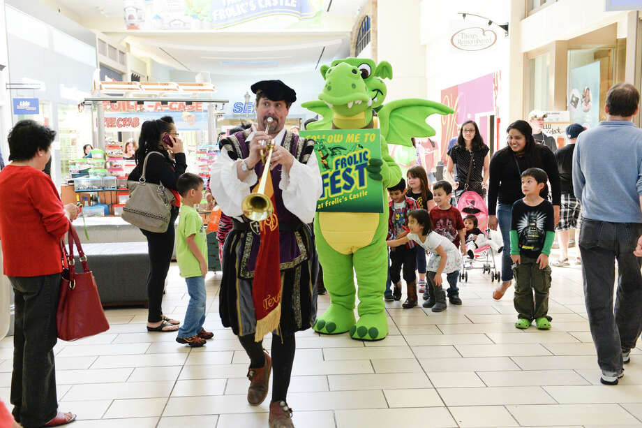 Frolic and Heralder lead children Through Memorial City Mall to the FrolicFest. Photo: MetroNational