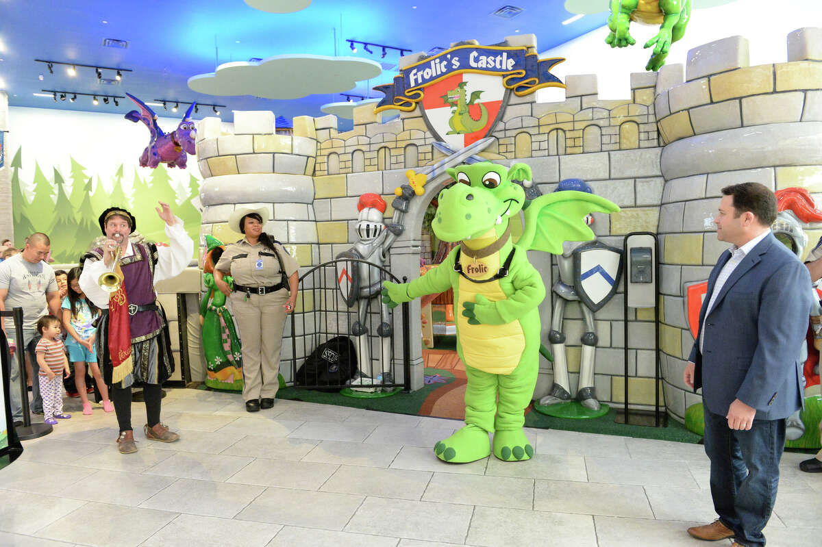 Frolic, the friendly green dragon, emerges From Frolic's Castle.