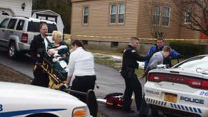 Police and medics respond to a domestic dispute at 90 Mountain View Ave. where a man attacked his parents Friday morning, March 27, 2015, in Rensselaer, N.Y. (Marty Miller/Special tot he Times Union)