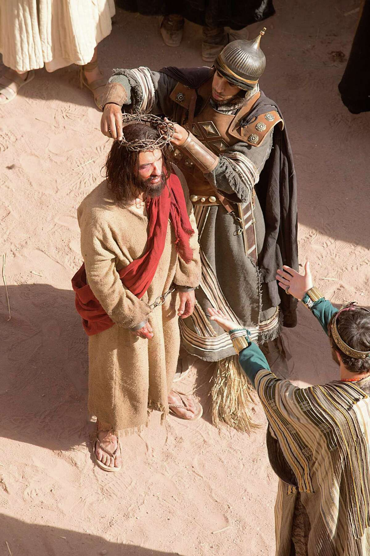 """A crown of thorns is placed on the head of Jesus (Haaz Sleiman) in National Geographic Channel's """"Killing Jesus,"""" airing March 29 A crown of thorns is placed on the head of Jesus.é¢â'¨é¢â'¨(photo credit: National Geographic Channels/Kent Eanes)"""