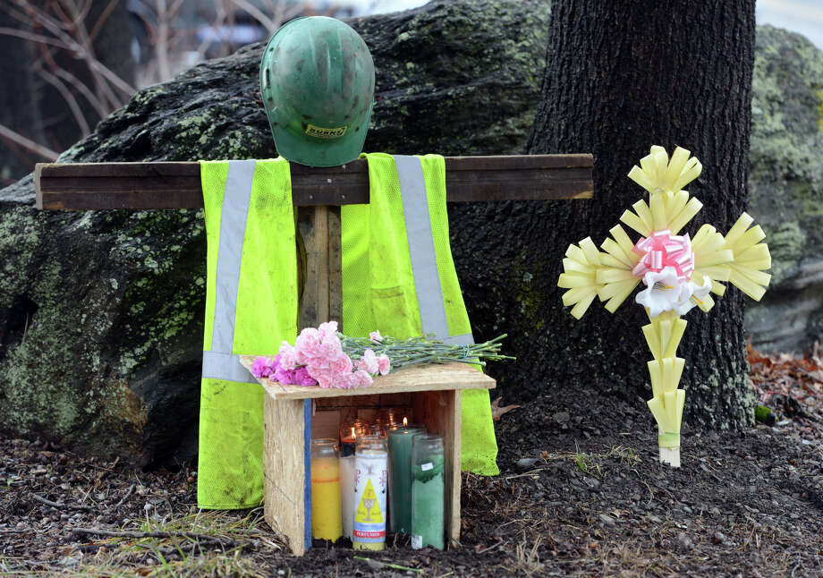 A memorial stands at the corner of Chopsey Hill and Pond Street in Bridgeport for murder victim Jose Araujo, a construction worker fatally shot on Thursday. Photo: Autumn Driscoll / Connecticut Post