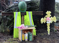 A memorial stands at the corner of Chopsey Hill and Pond Street in Bridgeport for murder victim Jose Araujo, a construction worker fatally shot on Thursday.