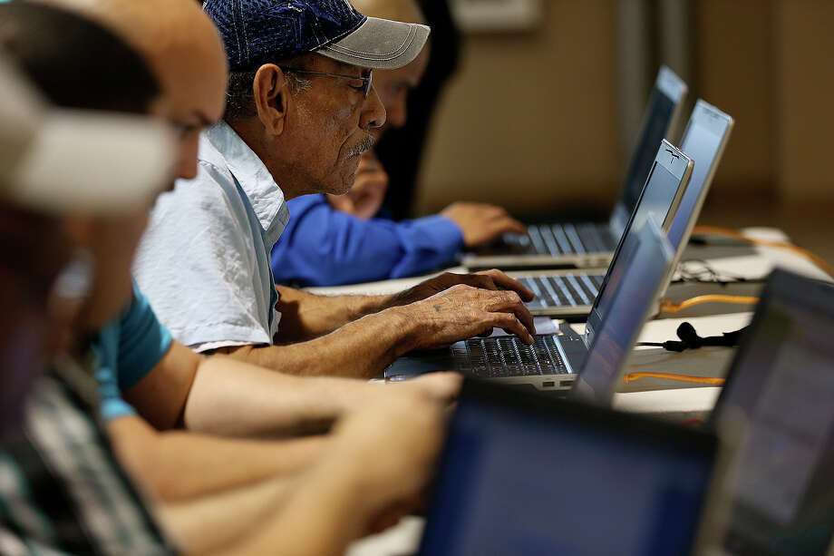 A veteran fiills out an application during a recent San Antonio Military Hiring Fair and Veterans Information Village. Veterans carried a burden for us; we should help them get an education. Photo: Jerry Lara /San Antonio Express-News / © 2015 San Antonio Express-News