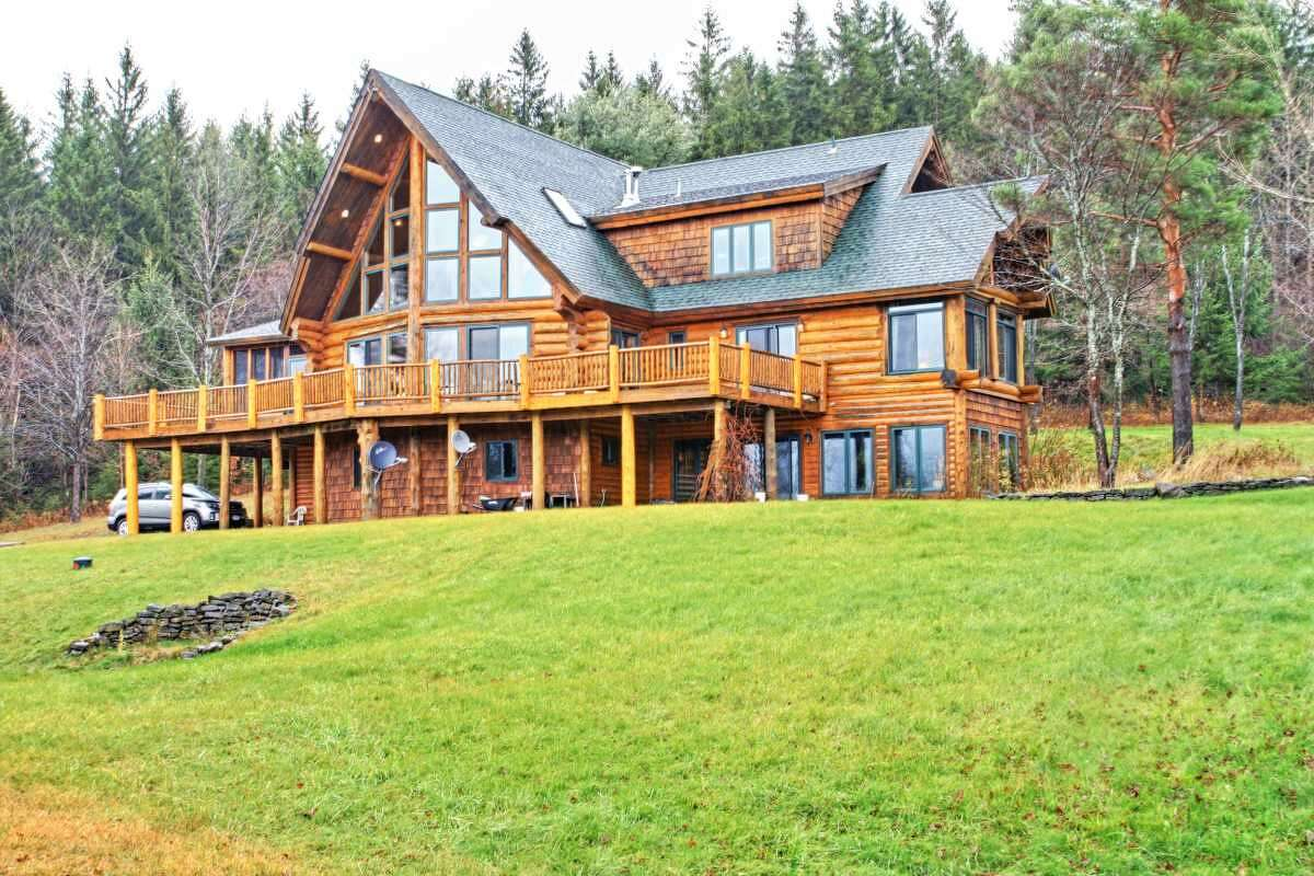 The log home at 667 County Route 353, Rensselaerville was made with Canadian spruce trees. It is 5,463 square feet, three bedrooms, 3 1/2 bathrooms and sits on 30 acres. It is listed at $1,250,000.