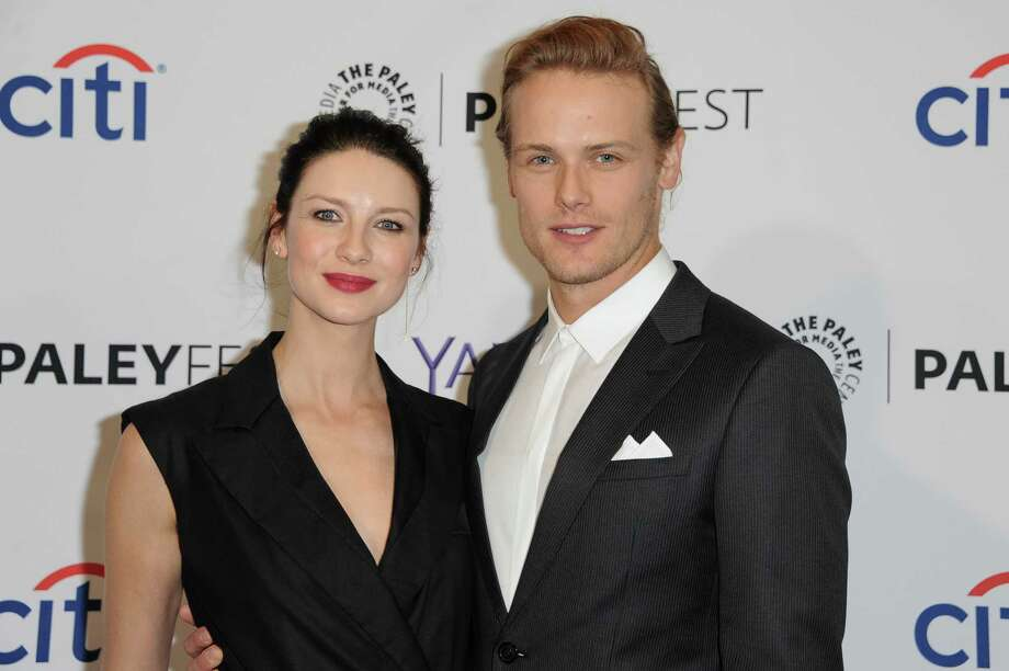 "Caitriona Balfe, left, and Sam Heughan arrive at the 32nd Annual Paleyfest : ""Outlander"" held at The Dolby Theatre on Thursday, March 12, 2015, in Los Angeles. (Photo by Richard Shotwell/Invision/AP)  ORG XMIT: MER2015031223163956 Photo: Richard Shotwell / Invision"