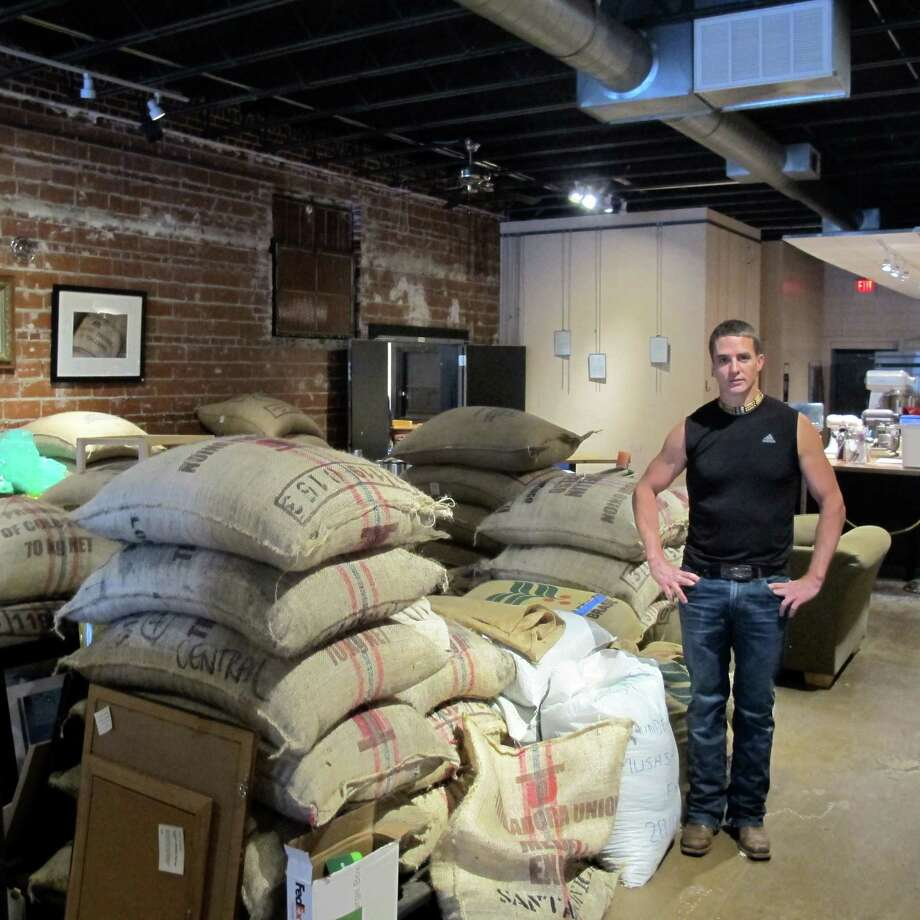 Brian Franklin, owner of DoubleShot Coffee Co., stands with some of his raw materials on Thursday, March 19, 2015 in Tulsa, Okla. Franklin's shop, part of the city's hip revival, served as a model for a sketch on the popular comedy show Portlandia. With a re-energized downtown and a welcome mat for a much younger generation of business owners and urban dwellers, this meat-and-potatoes Midwestern city of about 400,000 is hitting a stride. (AP Photo/Justin Juozapavicius) ORG XMIT: MER2015032514062212 Photo: Justin Juozapavicius / AP