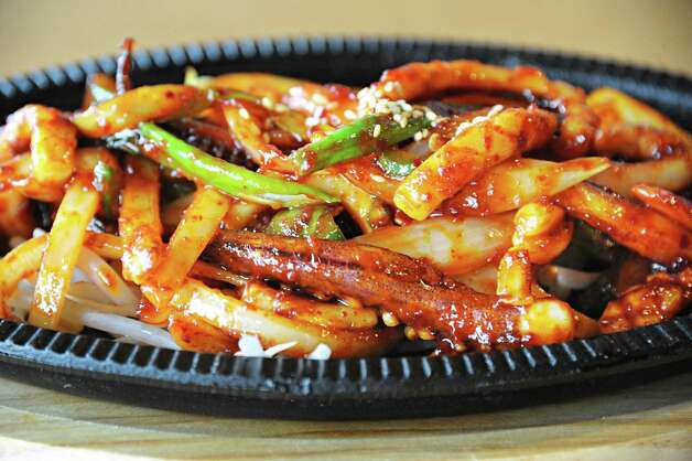 An order of spicy squid at Namu Korean BBQ on Central Avenue Friday March 20, 2015 in Colonie, NY.   (John Carl D'Annibale / Times Union) Photo: John Carl D'Annibale / 10031115A