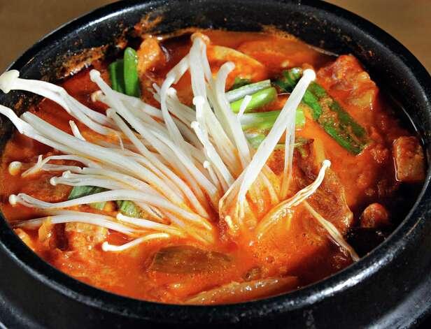 Kimchi stew at Namu Korean BBQ on Central Avenue Friday March 20, 2015 in Colonie, NY.   (John Carl D'Annibale / Times Union) Photo: John Carl D'Annibale / 10031115A