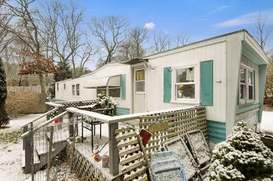 This rather rundown trailer house that sits in the middle of the posh Hamptons is listed for $1.2 million, up by $100,000 from last month. The house's large price tag may leave people scratching their heads in confusion, but it's location near the popular Indian Wells Beach actually makes it seem like a bargain. Next door, a home just sold for $4 million.Source: Douglas Elliman Real Estate  Photo: Courtesy, Douglas Elliman Real Estate