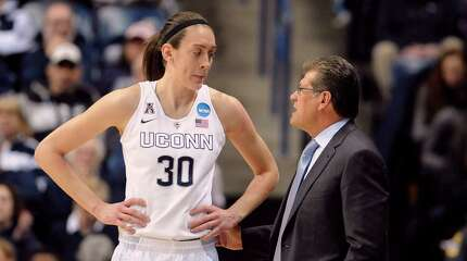 Connecticut's Breanna Stewart, left, talks with Connecticut head coach Geno Auriemma during the first half of a women's college basketball game against Rutgers in the second round of the NCAA tournament, Monday, March 23, 2015, in Storrs, Conn. (AP Photo/Jessica Hill) ORG XMIT: CTJH102