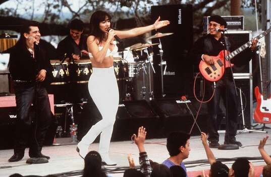 "HOLLYWOOD, CA - MARCH 23:  Actress Jennifer Lopez, who plays Selena in the movie ""Selena,"" performs with her band in one of the scenes from the movie.  ""Selena"" is about the tejano singer who is murdered by her fan club president. Photo: RICCO TORRES, Getty Images / AFP"