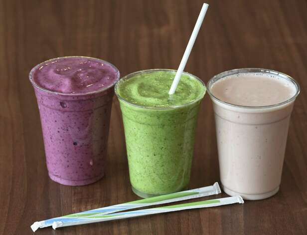 Three smoothies, Very Berry, left, Super Green, center and Strawberry-Banana at the  FX3 Fit Fast Food Restaurant Thursday afternoon March 5, 2015 in Queensbury, N.Y.   (Skip Dickstein/Times Union) Between 230 and 307 calories each. Photo: SKIP DICKSTEIN / 00030896A
