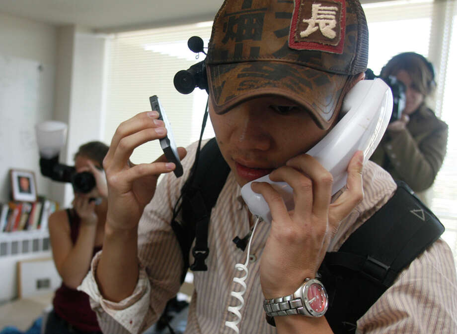 Justin Kan does a telephone interview with a Los Angeles TV station as he streams his life in 2007. Photo: Liz Hafalia / Sfc / The Chronicle