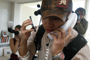 Justin Kan does a telephone interview with a Los Angeles TV station as he streams his life in 2007.
