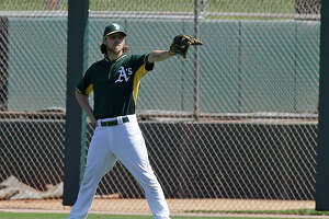 A's outfielder Josh Reddick likely to miss start of season - Photo