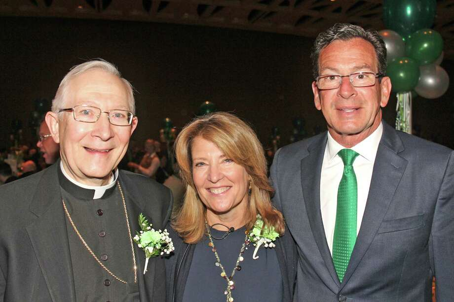 (from left) Archbishop Leonard Blair, Bigelow Tea President and CEO Cindi Bigelow, and Governor Dannel Malloy attended the annual ArchbishopâÄôs St. Patrick Day Breakfast held at the Connecticut Convention Center in Hartford. Photo: Contributed Photo / Greenwich Time Contributed