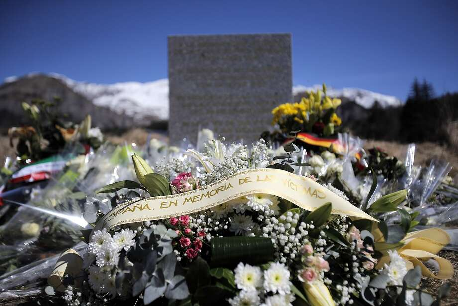 A stele and flowers laid in memory of the victims are placed in the area where the Germanwings jetliner crashed in the French Alps, in  Le Vernet, France, Friday, March 27, 2015. The crash of Germanwings Flight 9525 into an Alpine mountain, which killed all 150 people aboard, has raised questions about the mental state of the co-pilot. Authorities believe the 27-year-old German deliberately sought to destroy the Airbus A320 as it flew Tuesday from Barcelona to Duesseldorf. (AP Photo/Christophe Ena) Photo: Christophe Ena, Associated Press