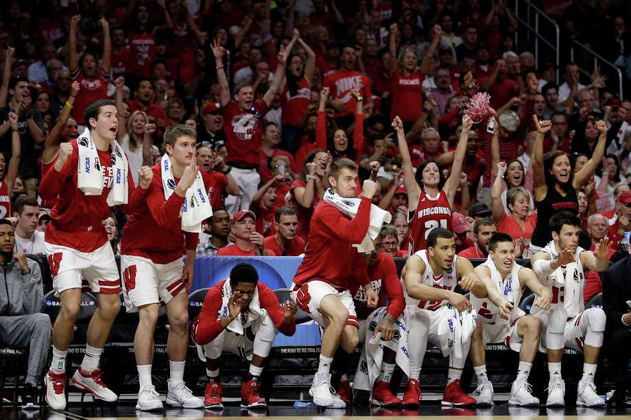 Players on the Wisconsin bench react to a play during the second half against North Carolina in the NCAA West Region semifinals on March 26, 2015, in Los Angeles. Photo: Jae C. Hong /Associated Press / AP