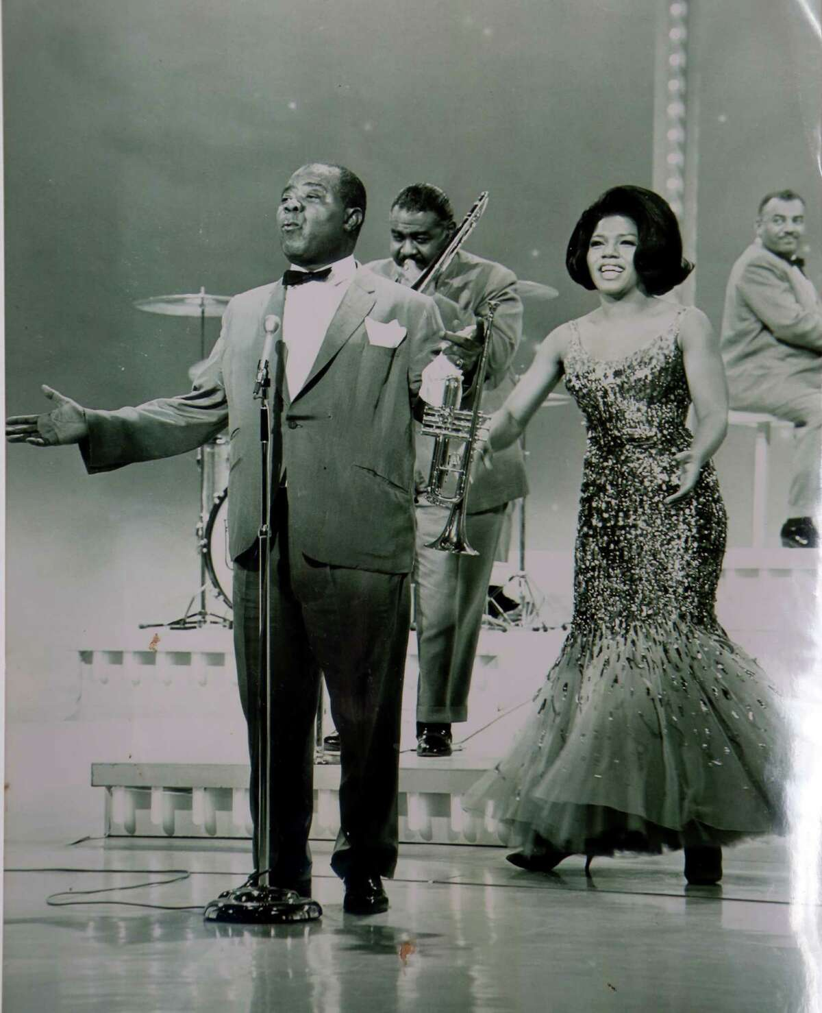 Jewel Brown is shown in a photo taken around 1963 as a vocalist with Louie Armstrong's All Star Band. She is a long-time resident of the Third Ward.