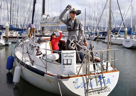 Jacob Best and friends wave farewell as they set sail for the day on Dan Knox's 36-foot sailboat from Marina Village, Alameda on Sunday, March 22, 2015.