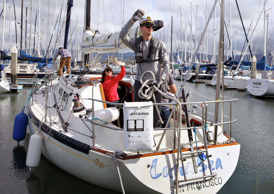Jacob Best and friends wave farewell as they set sail for the day on Dan Knox's 36-foot sailboat from Marina Village in Alameda. Photo: Amy Osborne / The Chronicle / ONLINE_YES