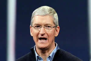 Apple CEO Tim Cook plans to give away most of his fortune - Photo
