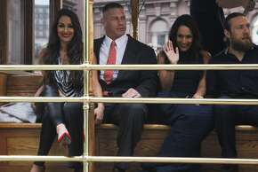 (From left) Nikki Bella, John Cena, Brie Bella and Daniel Bryan arrive on a cable car before a WrestleMania 31 media event held at The Fairmont Hotel in San Francisco, Calif. Friday, March 27, 2015.