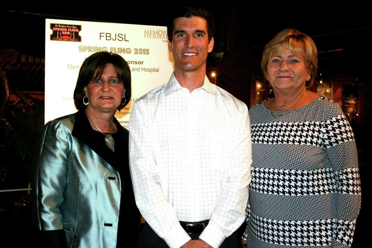 Supporting the Service Leagueés event are members of the Hope For Three board. From left are Jacque Burgess, Patrick LaRue, board president, and Mary Ann Gardner.