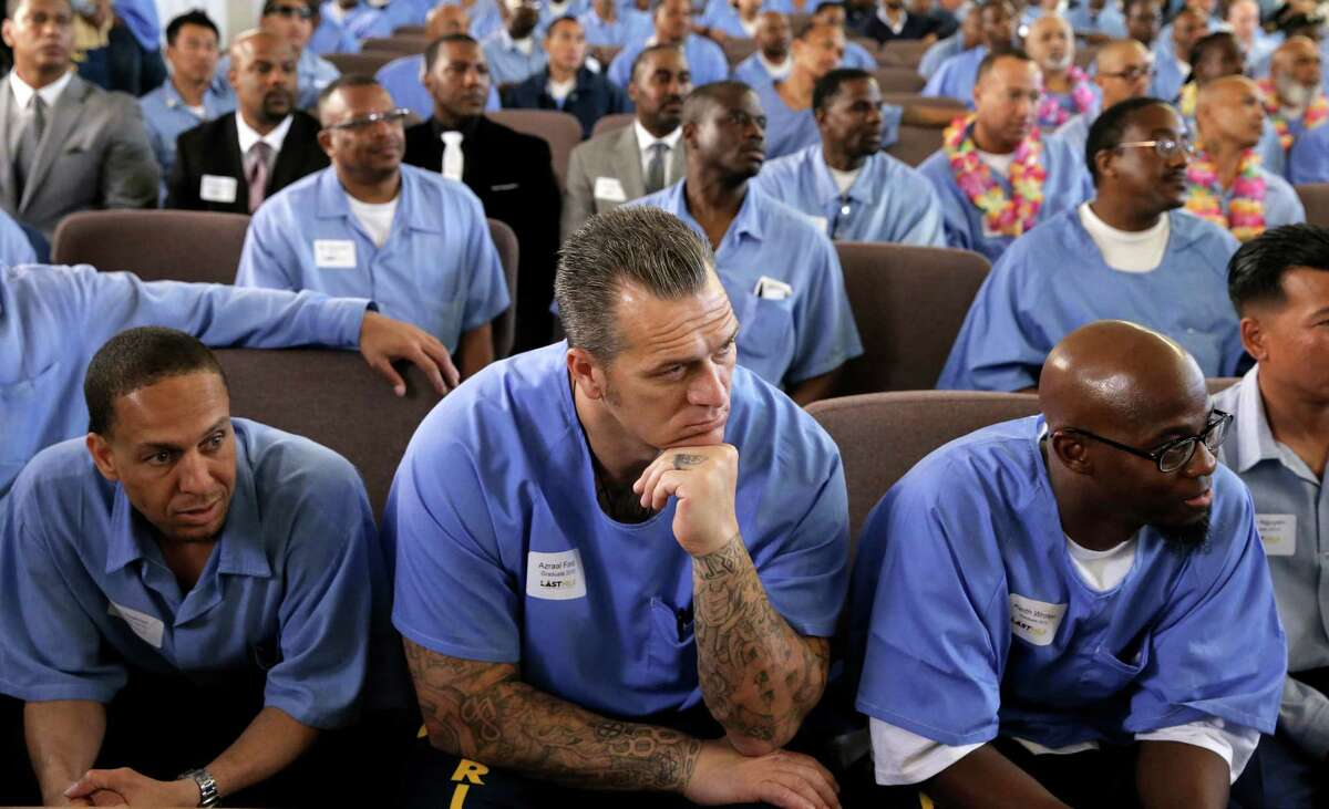 Graduates of San Quentin Prison's The Last Mile program (l to r) Sam Hearnes, Azraal Ford and Keith Wroten listen to fellow presenters as they show off their startup ideas on stage at Demo Day in San Rafael, Calif., on Fri. March 27, 2015. The Last Mile, a nonprofit based in San Francisco, is an innovative approach to recidivism prevention. It is the first prison program in California, and the US, that focuses on technology entrepreneurship.