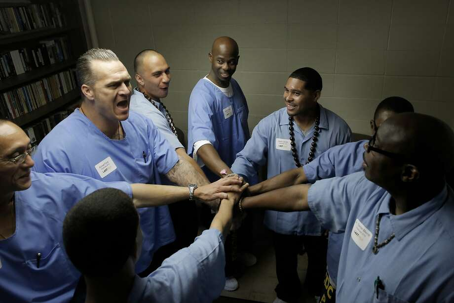 Graduates of San Quentin Prison's The Last Mile program are rallied together backstage by Azraal Ford, (to left) as they prepare to present their startup ideas at Demo Day in San Rafael, Calif., on Fri. March 27, 2015. The Last Mile, a nonprofit based in San Francisco, is an innovative approach to recidivism prevention. It is the first prison program in California, and the US, that focuses on technology entrepreneurship. Photo: Michael Macor, The Chronicle