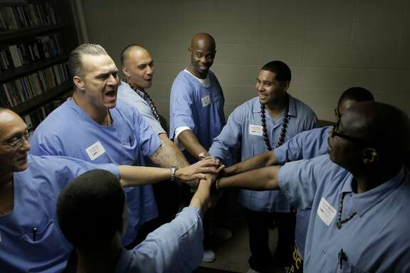 Graduates of San Quentin Prison's The Last Mile program are rallied together backstage by Azraal Ford, (to left) as they prepare to present their startup ideas at Demo Day in San Rafael, Calif., on Fri. March 27, 2015. The Last Mile, a nonprofit based in San Francisco, is an innovative approach to recidivism prevention. It is the first prison program in California, and the US, that focuses on technology entrepreneurship.