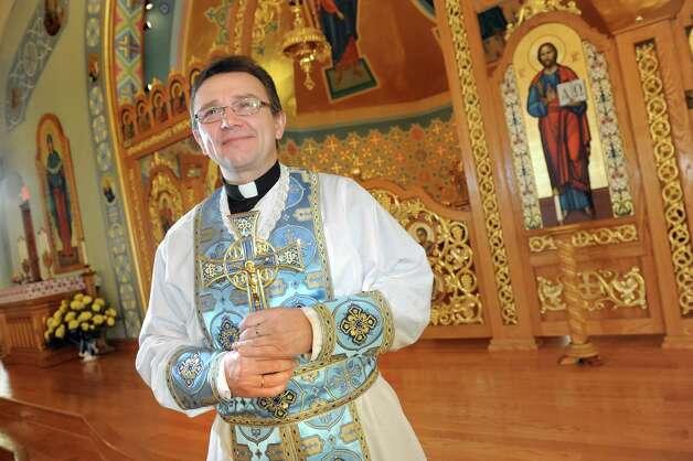 Rev. Mikhail Myshchuk on Wednesday, March 25, 2015, at St. Nicholas Ukrainian Catholic Church in Watervliet, N.Y. (Cindy Schultz / Times Union) Photo: Cindy Schultz / 10031116A
