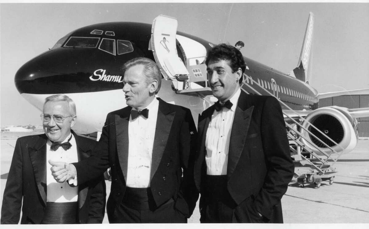 Left to right: George Becker (Sea World CEO), Herb Kelleher (Chairman of Southwest Airlines) and Mayor Henry Cisneros (May 1988)