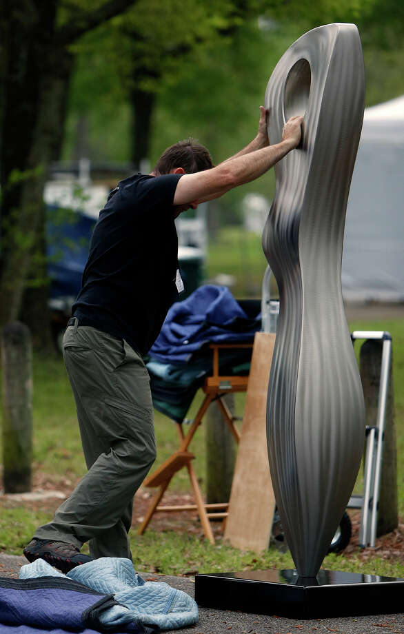 James Hill sets up his sculptures in preparation for the Bayou Art Festival at Memorial Park, Thursday, March 26, 2015, in Houston. More than 300 artists in 19 mediums encompassing fine arts and crafts are showcased in this popular outdoor festival. Photo: Cody Duty, Houston Chronicle / © 2015 Houston Chronicle
