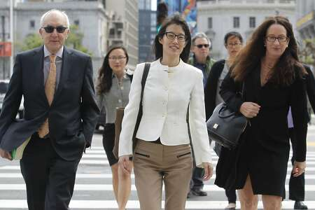Ellen Pao (center) arrives with her legal team to hear the verdict in her lawsuit against former employer Kleiner Perkins in San Francisco, Calif. on Friday, March 27, 2015.