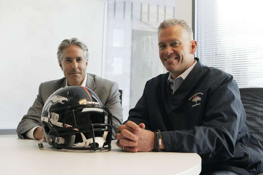 Vice President and player's agent of Southern Marin Youth Football Philip Cooke and President of Southern Marin Youth Football Joe Rafter show off new technologies for football helmets. Photo: Sophia Germer, The Chronicle