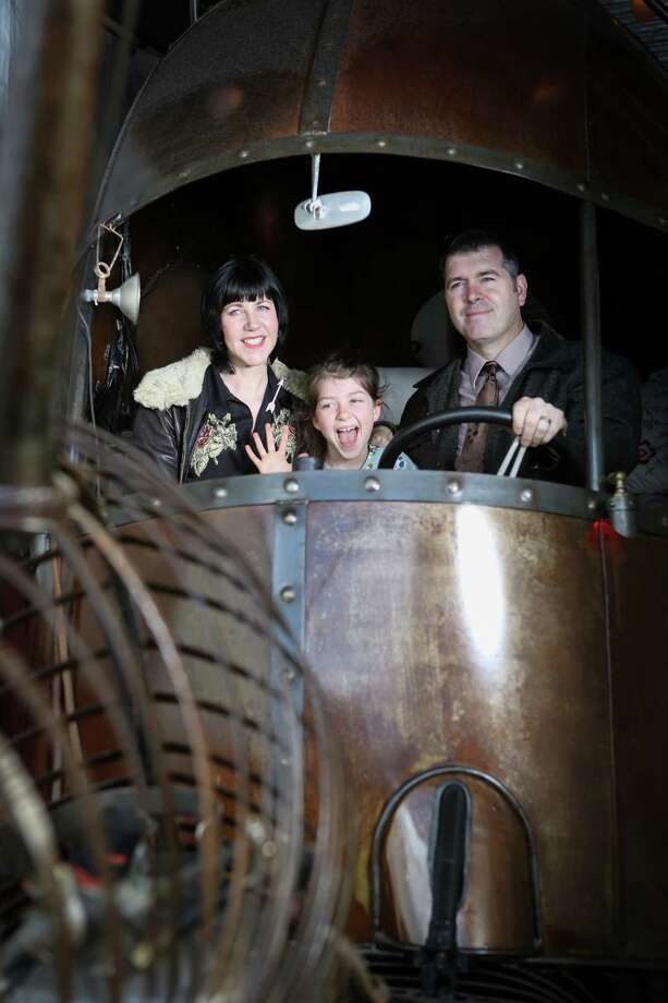 "Metal working team, Jon Sarriugarte and wife Kyrsten Mate, inside the ""Snail Car."" Photo: Amy Osborne / The Chronicle / ONLINE_YES"