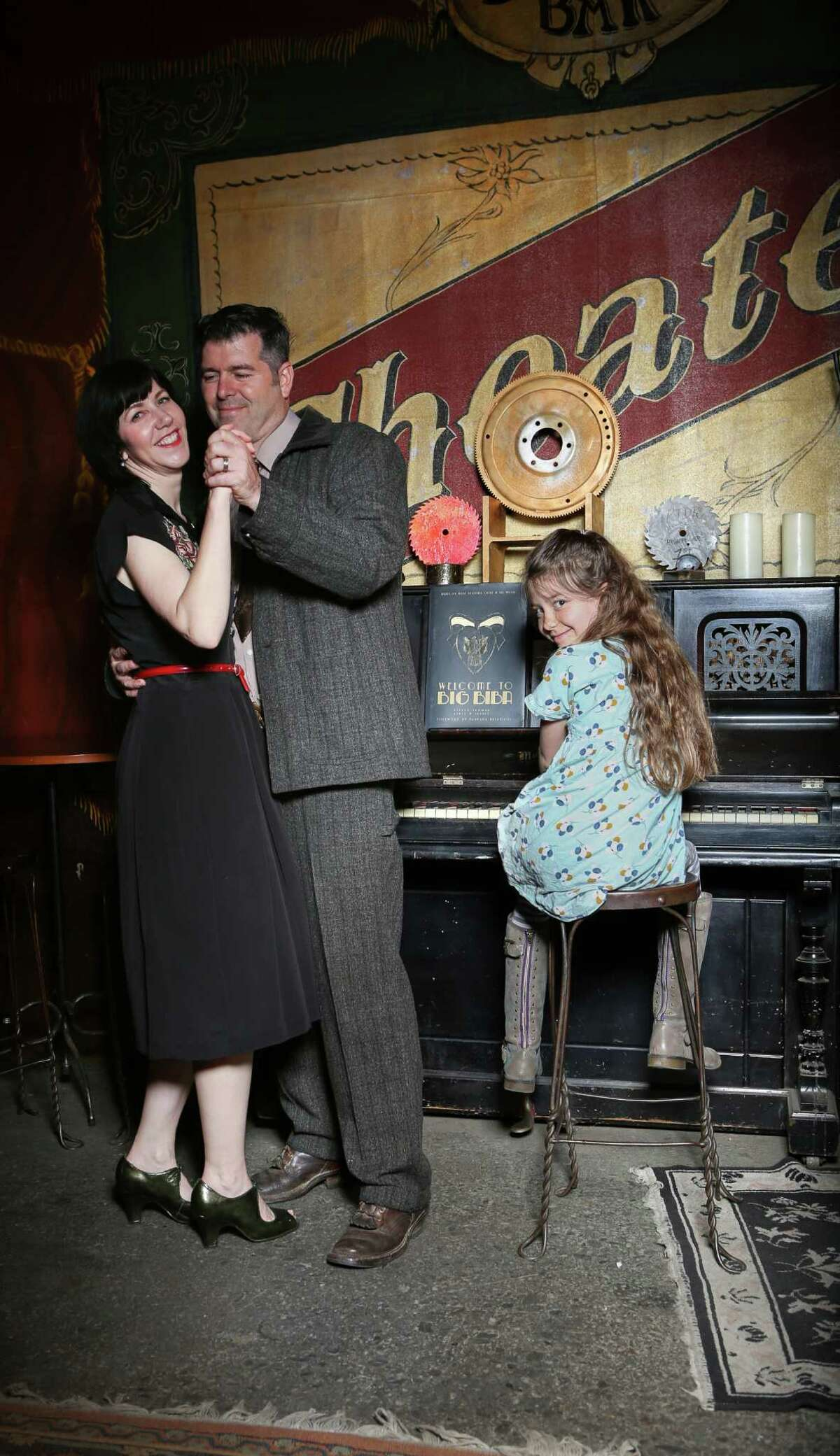 Stylish and artistic couple Kyrsten Mate and Jon Sarriugarte, with daughter Zolie, favor 1940s attire.