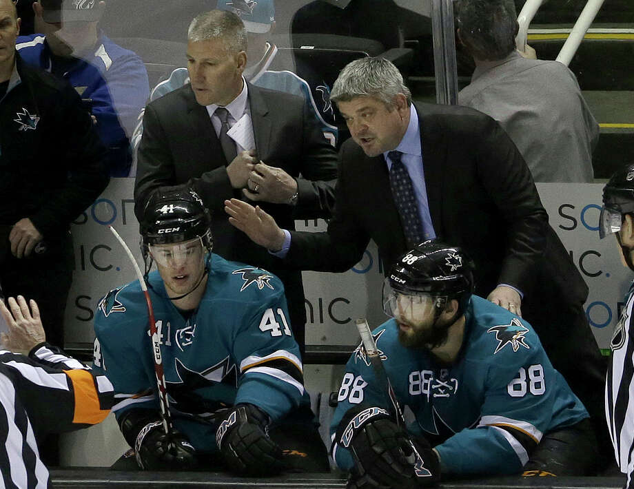 For Todd McLellan (center), who has a 307-160-65 record with San Jose, failure to take his team to the playoffs could make his seventh season as Sharks coach his last. Photo: Jeff Chiu / Associated Press / AP