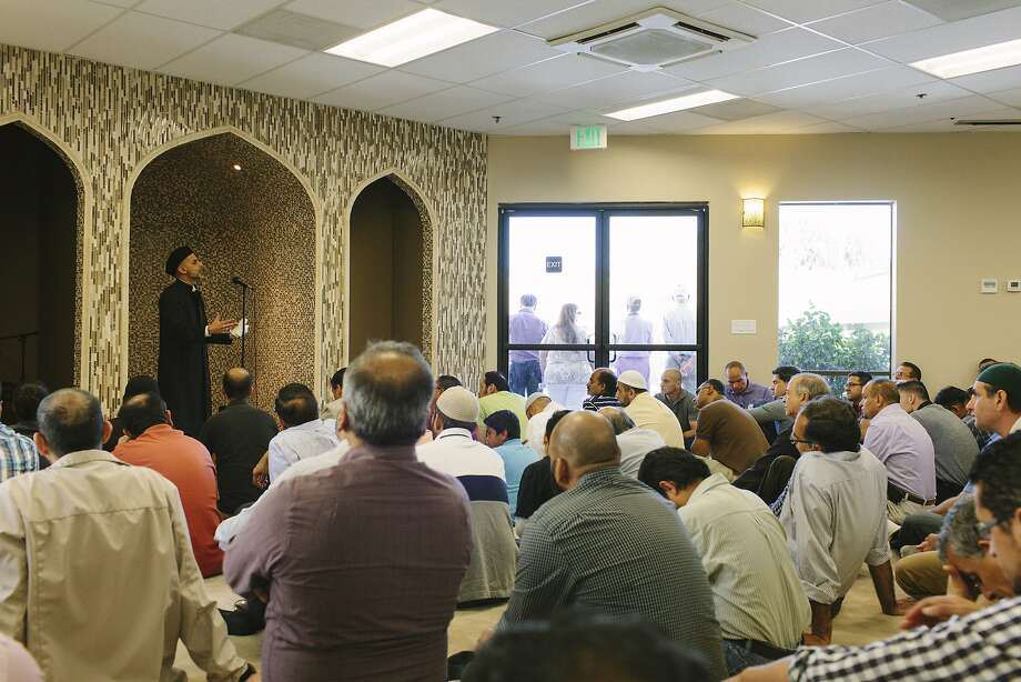 Khatib Parvez Ahmed gives a sermon at the San Ramon Valley Islamic Center Mosque as people of various faiths form a ring of solidarity outside. Photo: Peter Earl McCollough, Special To The Chronicle