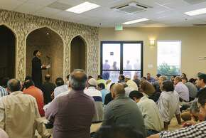 Khatib Parvez Ahmed gives a sermon at the San Ramon Valley Islamic Center Mosque as people of various faiths form a ring of solidarity outside, San Ramon, March 27, 2015.