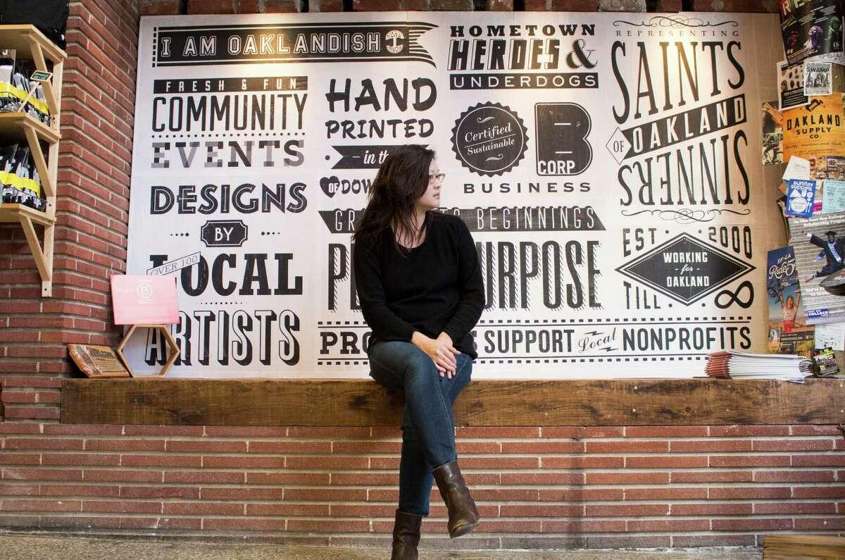 Oaklandish owner and co-founder Angela Tsay at the company's warehouse.