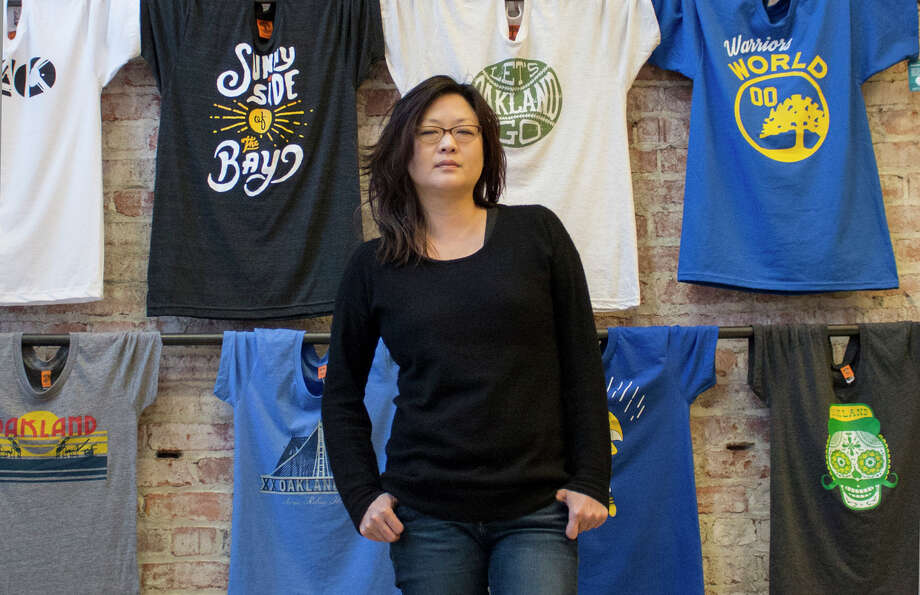 Angela Tsay, pictured at Oaklandish's flagship store, took over the company in 2006. Photo: Jessie Schiewe / ONLINE_CHECK
