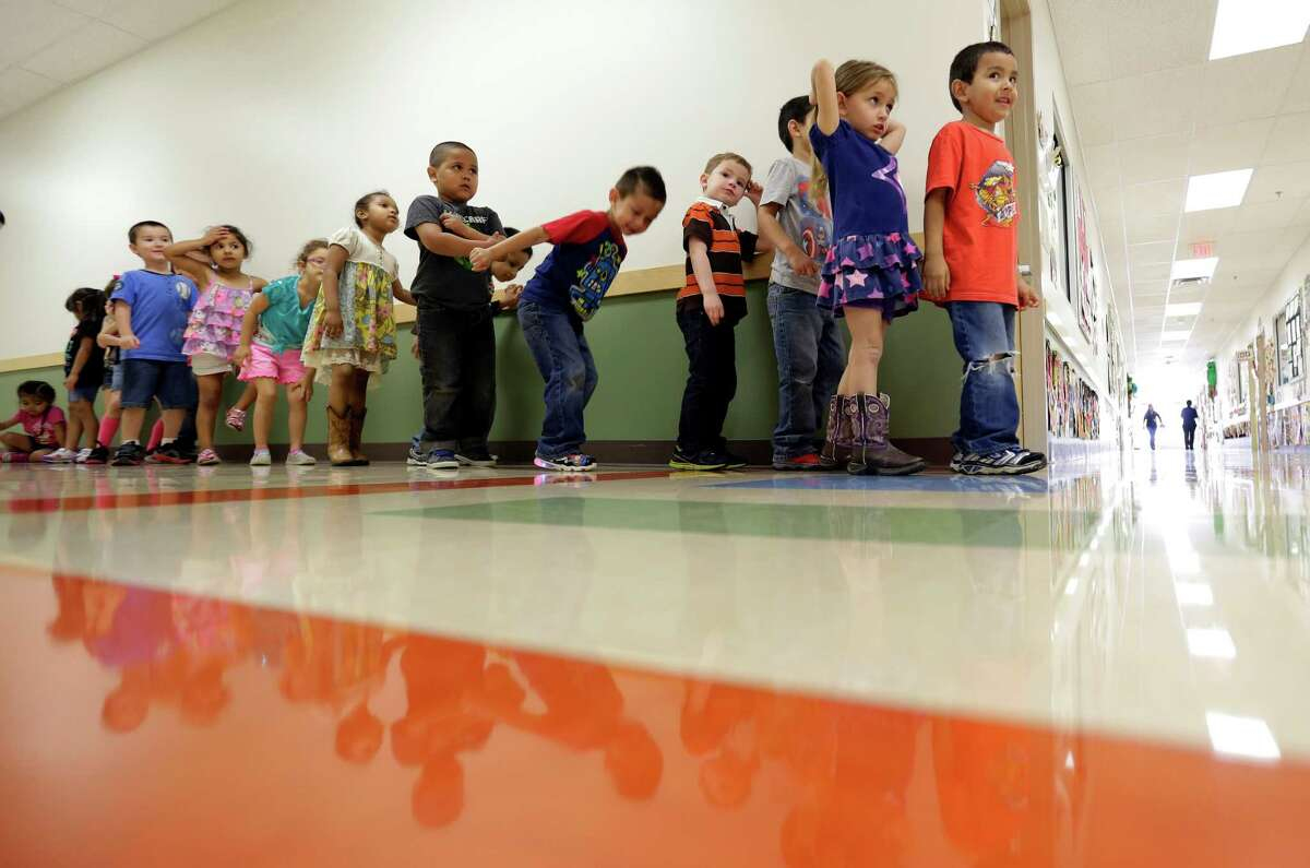 Pre-K students line up outside a classroom at the South Education Center in San Antonio. (AP Photo/Eric Gay)