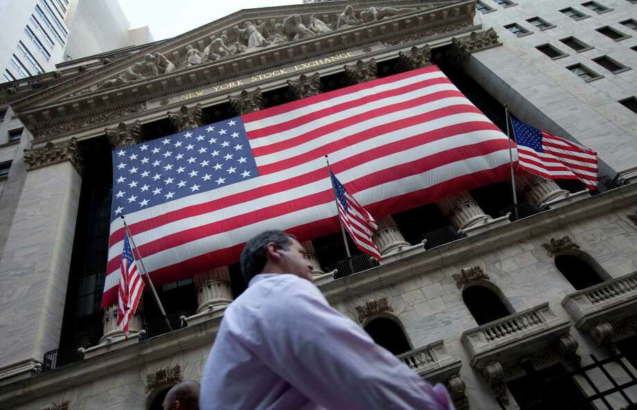 FILE - In this Monday, Aug. 8, 2011, file photo, a pedestrian walks past the New York Stock Exchange in New York. U.S. stocks were mostly unchanged Friday, March 27, 2015, after four straight days of losses. (AP Photo/Jin Lee, File) ORG XMIT: NY115 Photo: Jin Lee / FR159730 AP