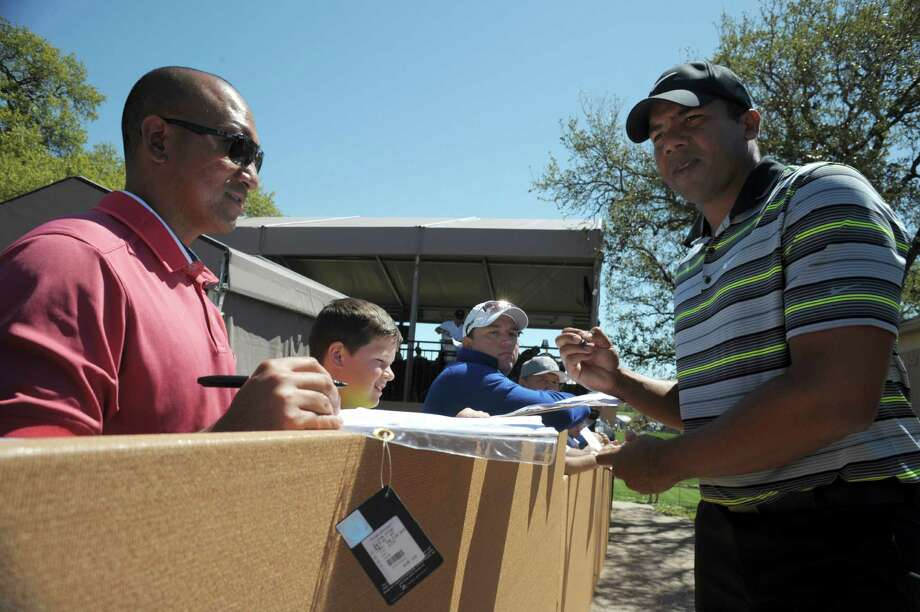 Jhonattan Vegas, an immigrant from Venezuela, signs autographs after completing the second round of the Valero Texas Open at TPC San Antonio on Friday, March 27, 2015. Photo: Billy Calzada, Staff / San Antonio Express-News / San Antonio Express-News