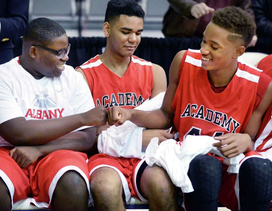 Albany Academy's #44 Hameir Wright, right, and team mate Nick Anyebunam, left, celebrate their victory over Springfield Gardens in their Class A Federation Tournament Semifinal at SEFCU Arena Friday March 27, 2015 in Albany, NY. At center is Langston Lanier.  (John Carl D'Annibale / Times Union) Photo: John Carl D'Annibale / 00031188A