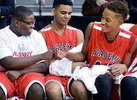 Albany Academy's #44 Hameir Wright, right, and team mate Nick Anyebunam, left, celebrate their victory over Springfield Gardens in their Class A Federation Tournament Semifinal at SEFCU Arena Friday March 27, 2015 in Albany, NY. At center is Langston Lanier.  (John Carl D'Annibale / Times Union)