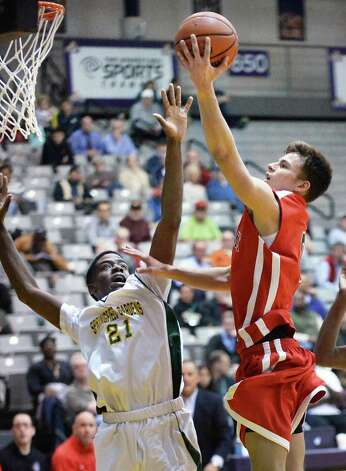 Albany Academy's #0 Sal Arena, right, gets past Springfield Gardens' 21 Vertell Dunham Jr. for two points during their Class A Federation Tournament Semifinal at SEFCU Arena Friday March 27, 2015 in Albany, NY.  (John Carl D'Annibale / Times Union) Photo: John Carl D'Annibale / 00031188A